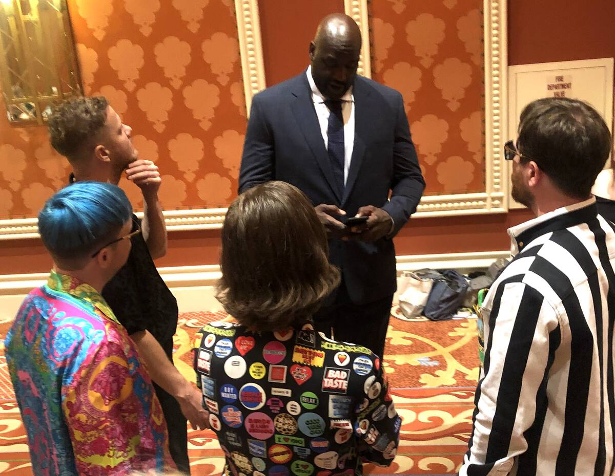 Shaquille O'Neal enters Dan Reynolds' number into his cell phone prior to the sixth annual TRF ...