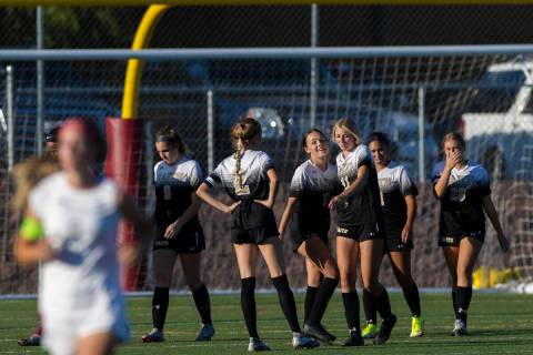 Faith Lutheran players celebrate after defeating Arbor View 2-1 during a girls high school socc ...