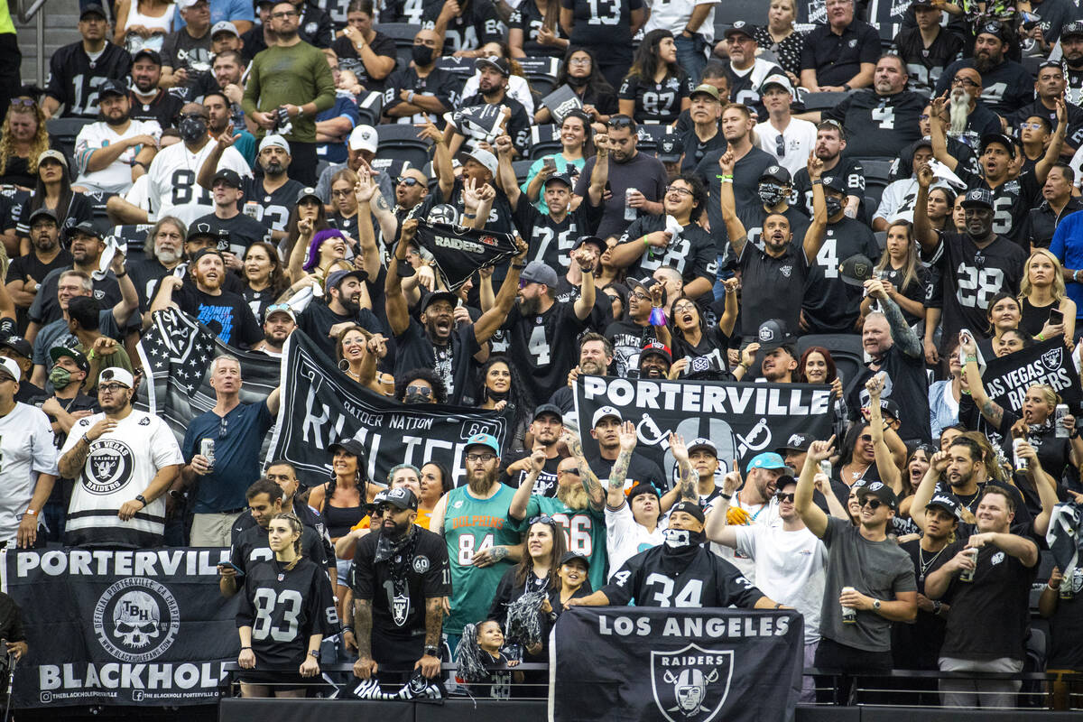 Raiders fans in the stands during the first half of their NFL game versus the Miami Dolphins at ...