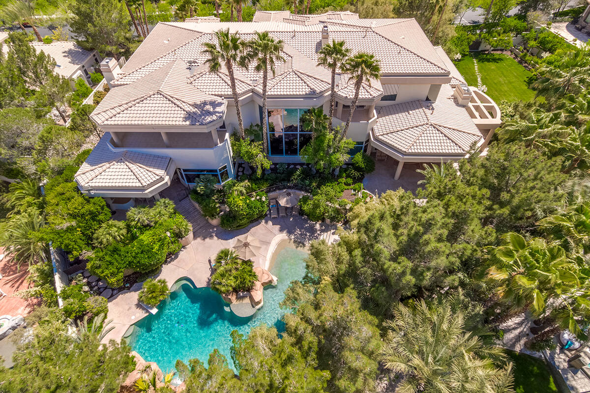 A mansion in Tournament Hills in Summerlin, 8912 Greensboro Lane, is listed for $13.9 million. ...