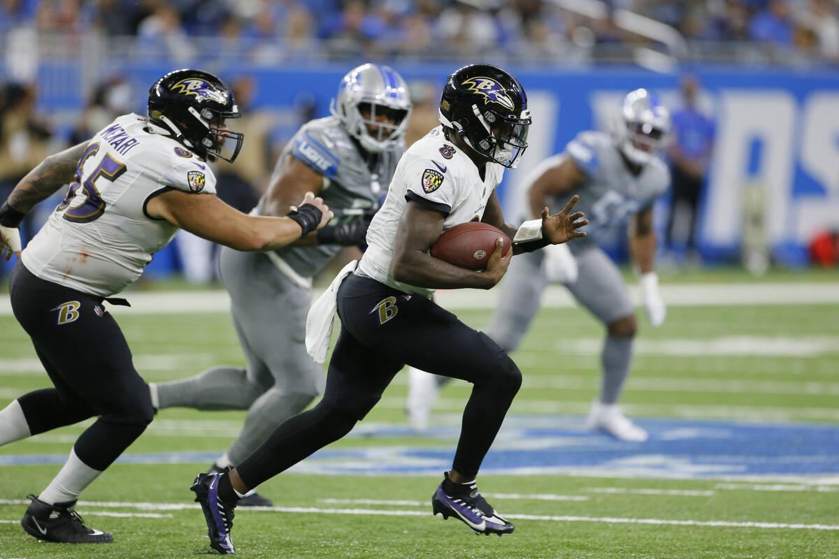 Baltimore Ravens quarterback Lamar Jackson (8) scrambles against the Detroit Lions in the secon ...