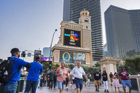 Pedestrians walk past Bellagio on Monday, Sept. 27, 2021, in Las Vegas. (Benjamin Hager/Las Veg ...
