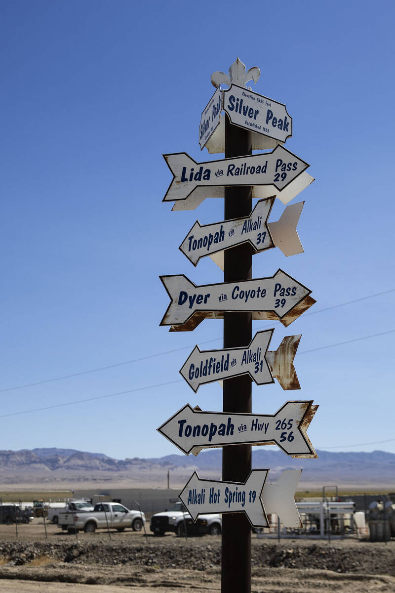 Signs of the nearby cities and towns are posted near Albemarle's lithium mine in Silver Peak, N ...