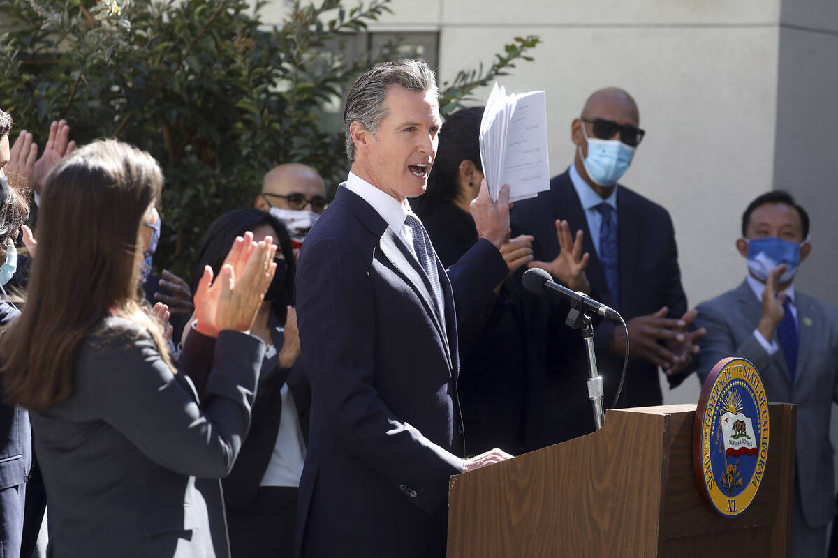 California Gov. Gavin Newsom speaks at a news conference to sign a number of housing bills at t ...