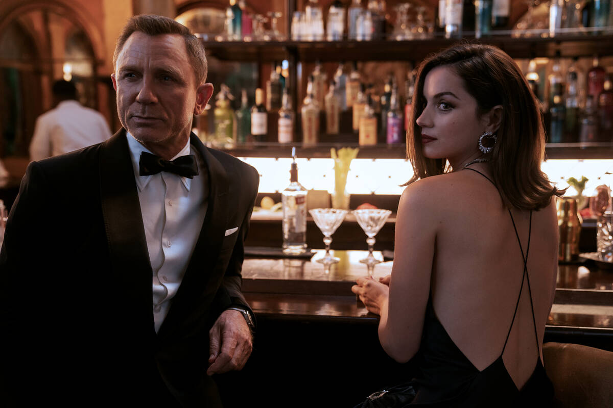"""Daniel Craig and Ana de Armas star in """"No Time to Die,"""" an EON Productions and Metro-Goldwyn-Ma ..."""