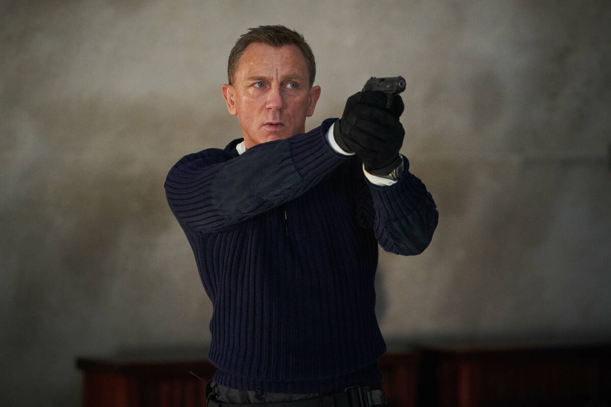 """James Bond (Daniel Craig) prepares to shoot in """"No Time to Die,"""" an EON Productions and Metro-G ..."""