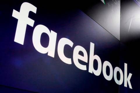 In this March 29, 2018, file photo, the logo for Facebook appears on screens at the Nasdaq Mark ...