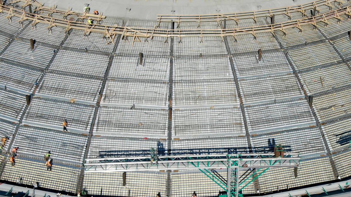 An aerial photo of workers on top of the MSG Sphere at the Venetian as construction continues o ...