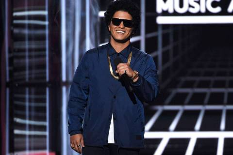 FILE - In this May 20, 2018, file photo, Bruno Mars presents the Icon award at the Billboard Mu ...