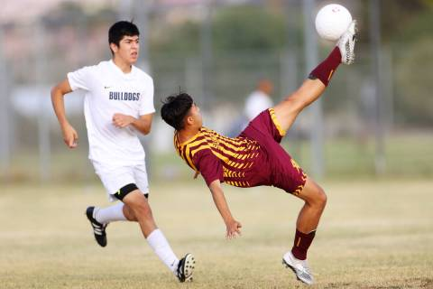 Del Sol's Jose Moran (18) kicks the ball at the goal during the first half of a soccer game at ...
