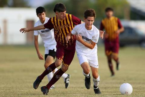 Eldorado's Jorge Sandoval (19) competes for the ball against Centennial's Ethan Leveque (6) dur ...