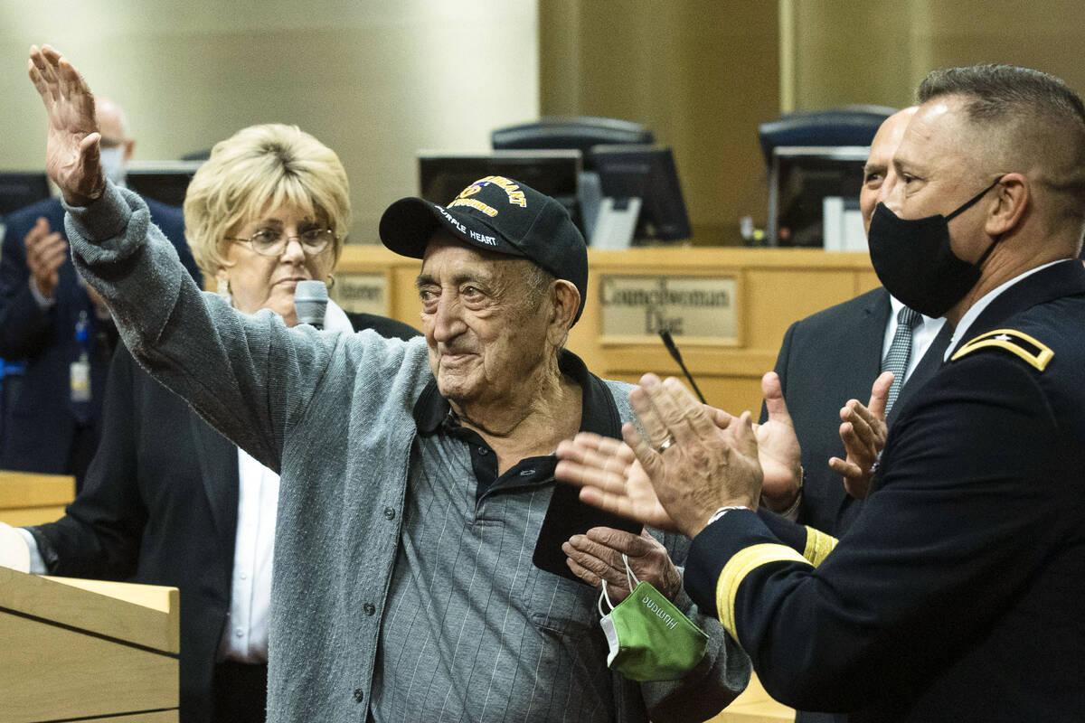 A 98-year-old World War II veteran, Onofrio Zicari, left, acknowledges the crowed after receivi ...
