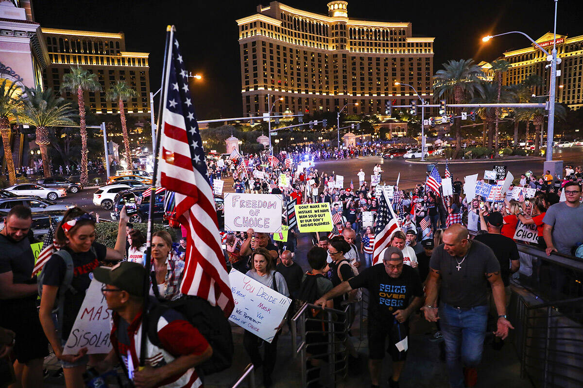 Protesters walk the Strip to protest COVID-19 government mandates, hosted by the non-profit Fre ...