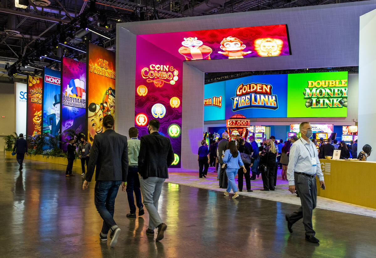 Attendees stroll about the Scientific Games Corp. display area during day 3 at the Global Gamin ...