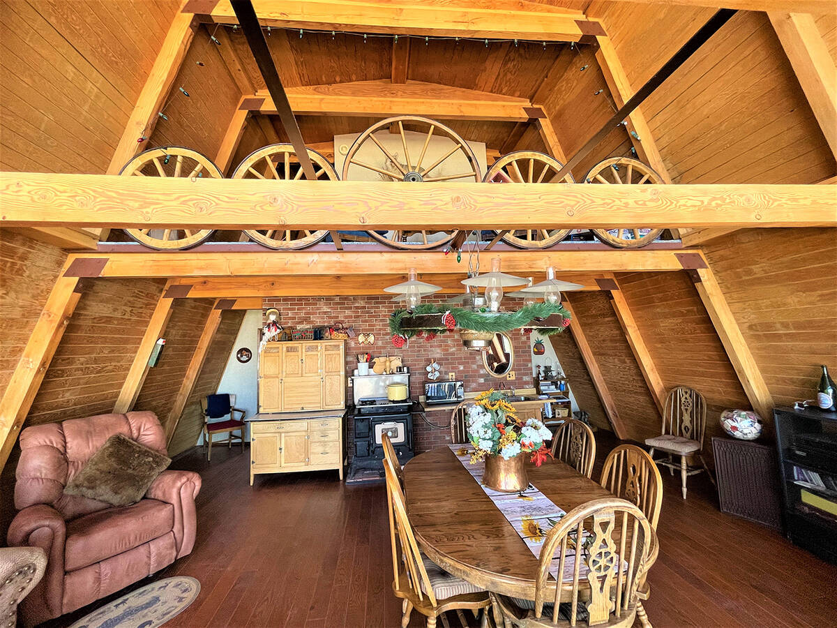 The cabin features a 300-pound custom wagon-wheel display. The grandiose fixture gives the dini ...