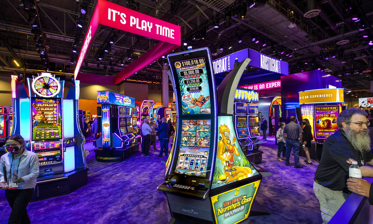 A wide variety of slots are ready for the play within the Aristocrat Gaming display area during ...