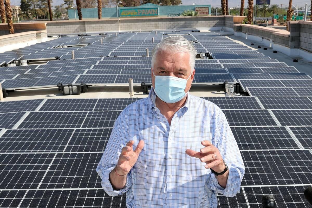 Nevada Gov. Steve Sisolak, seen at a rooftop solar facility in Las Vegas in August 2021. (K.M. ...