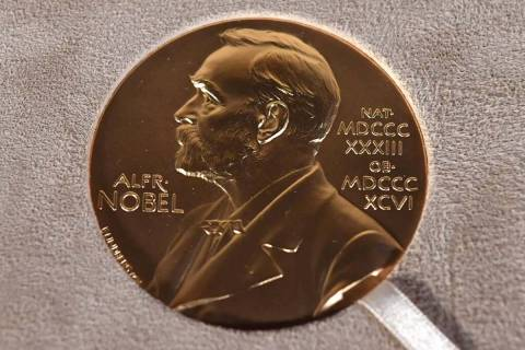 FILE - A Tuesday, Dec. 8, 2020 file photo of a Nobel medal displayed during a ceremony in New Y ...