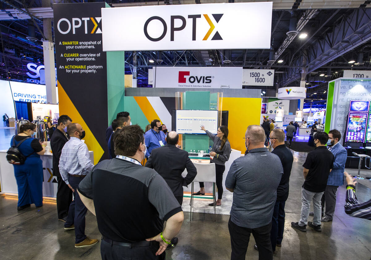 Brooke Fiumara with Optx, center, talks about their data analytics platform to possible clients ...