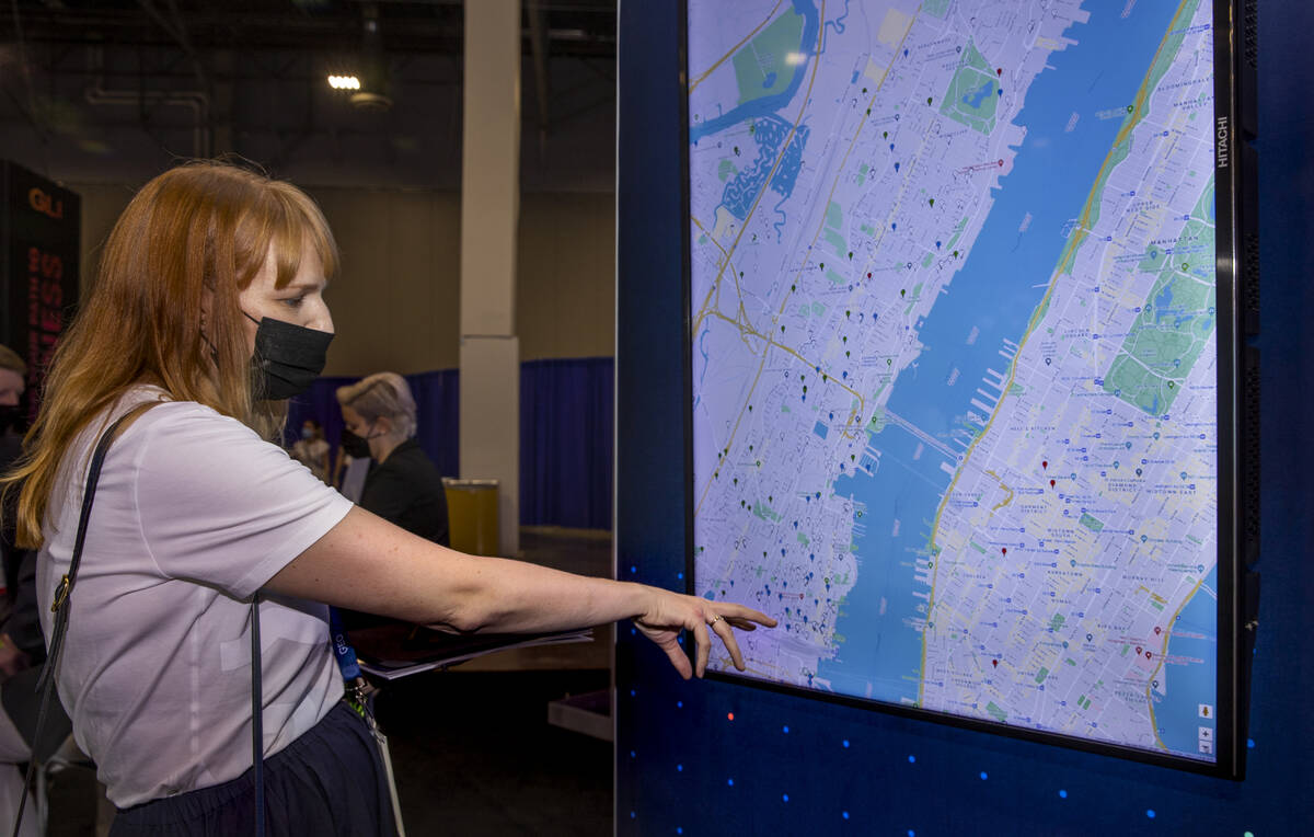 Lindsay Slader with Geocomply Solutions, Inc., shows how their system operates on an interactiv ...