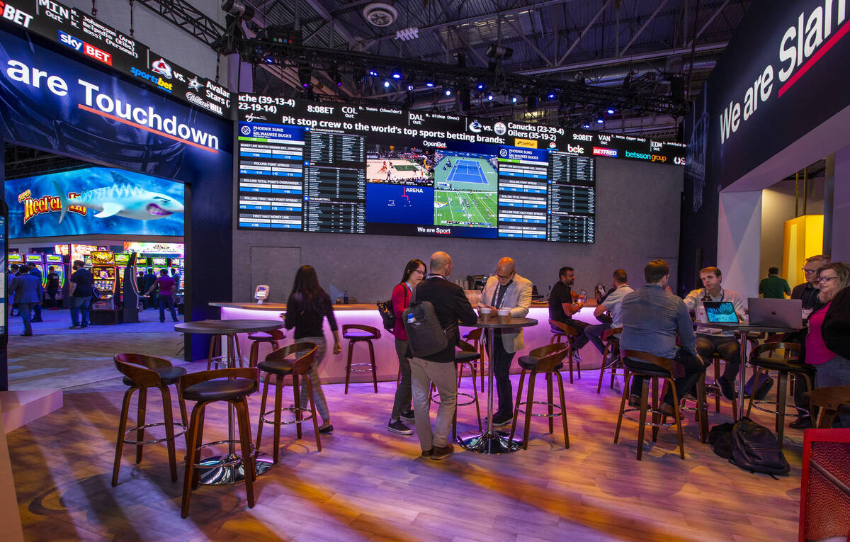 Attendees gather within the Scientific Games' OpenBet display during day 4 at the Global Gaming ...