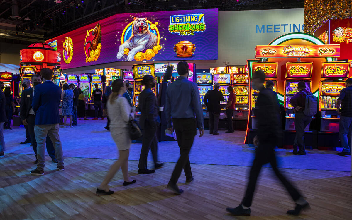 Attendees wander within the Scientific Games display area during day 4 at the Global Gaming Exp ...