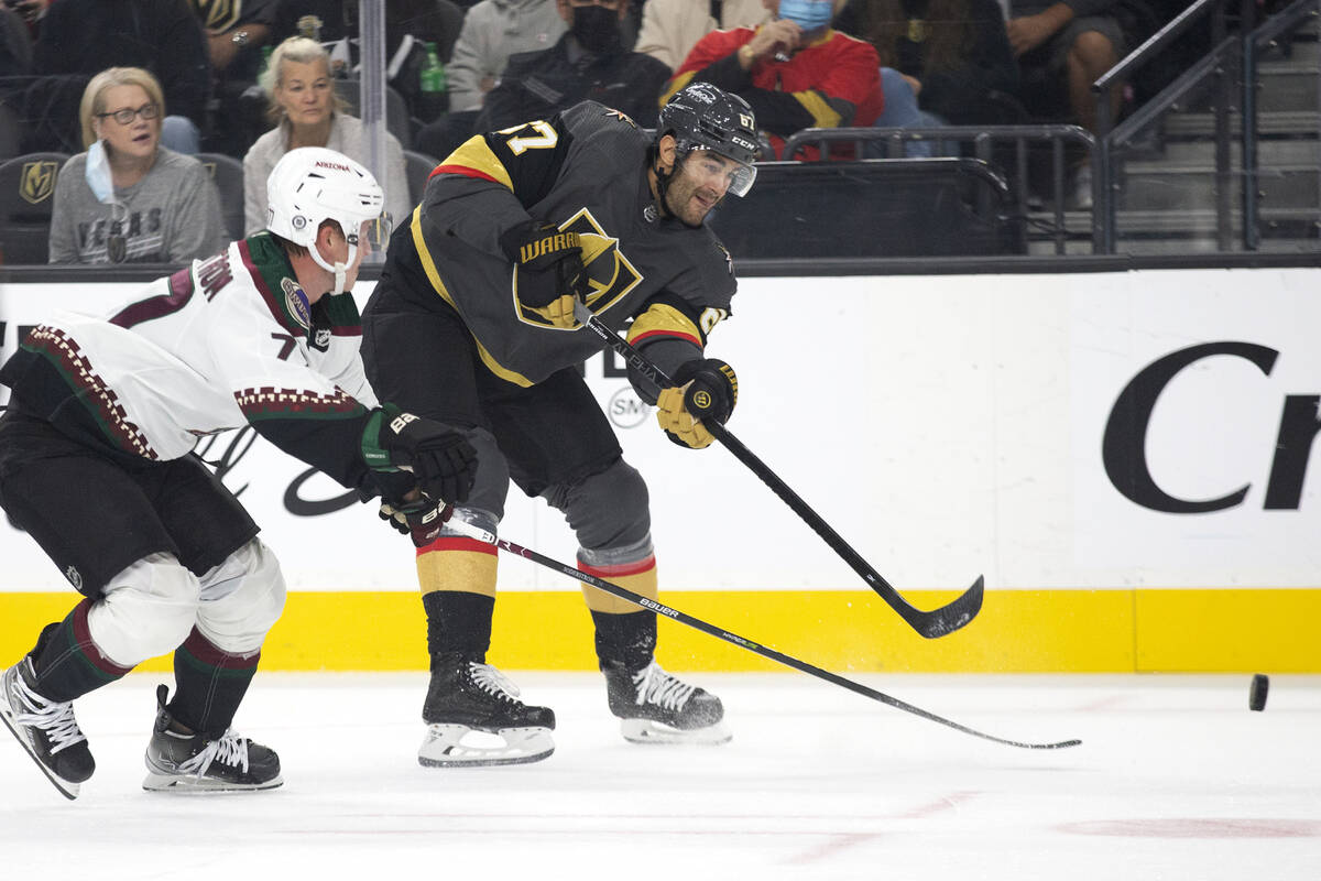 Golden Knights near  helping  Max Pacioretty (67) makes a changeable  connected  extremity   arsenic  Coyotes defenseman Victor ...