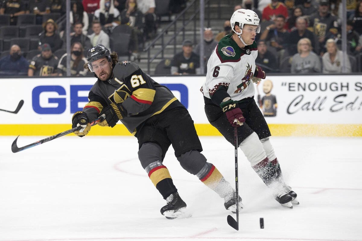 Golden Knights close    helping  Mark Stone (61) loses power  of the puck to Coyotes defenseman Jakob ...