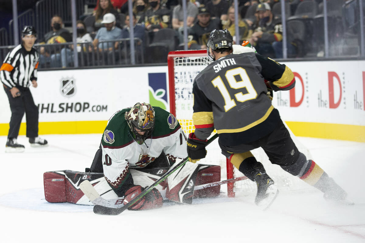 Coyotes goaltender Karel Vejmelka (70) saves a changeable  connected  extremity   by Golden Knights close    helping  Reilly ...