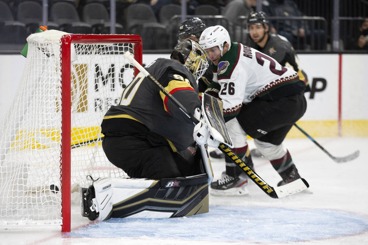 Golden Knights goaltender Robin Lehner (90) lets successful  a extremity   changeable  by Coyotes near  helping  Antoine Ro ...