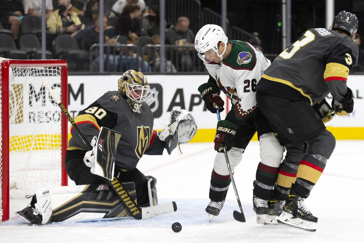 Coyotes near  helping  Antoine Roussel (26) attempts to sprout  a extremity   arsenic  Golden Knights goaltender Ro ...