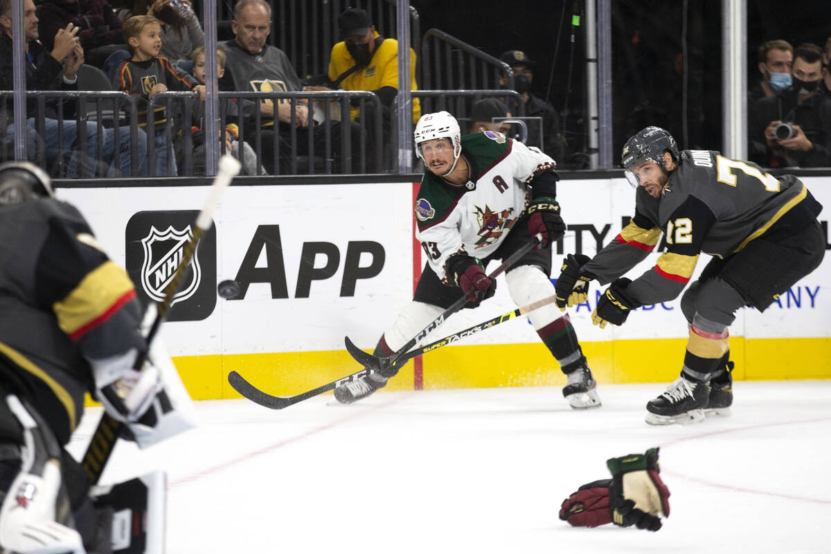 Coyotes halfway  Jay Beagle (83) takes a changeable  connected  Golden Knights goaltender Robin Lehner (90) arsenic  G ...