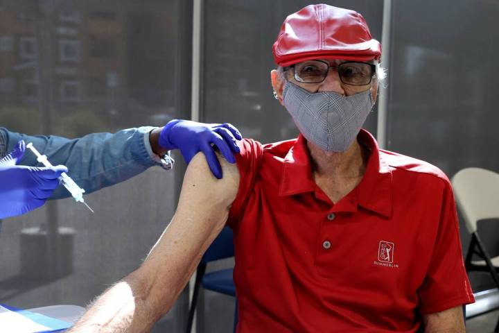 """Charles """"Buddy Charles"""" Wucinich, 84, of Las Vegas gets a Pfizer COVID-19 vaccine boo ..."""