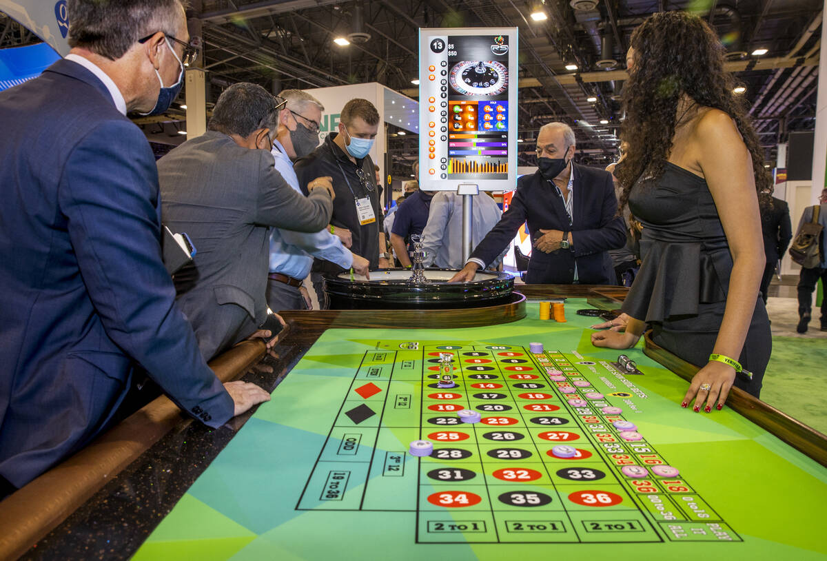 Attendees play a TCSJOHNHUXLEY Roulette wheel during day 2 of the Global Gaming Expo 2021 confe ...