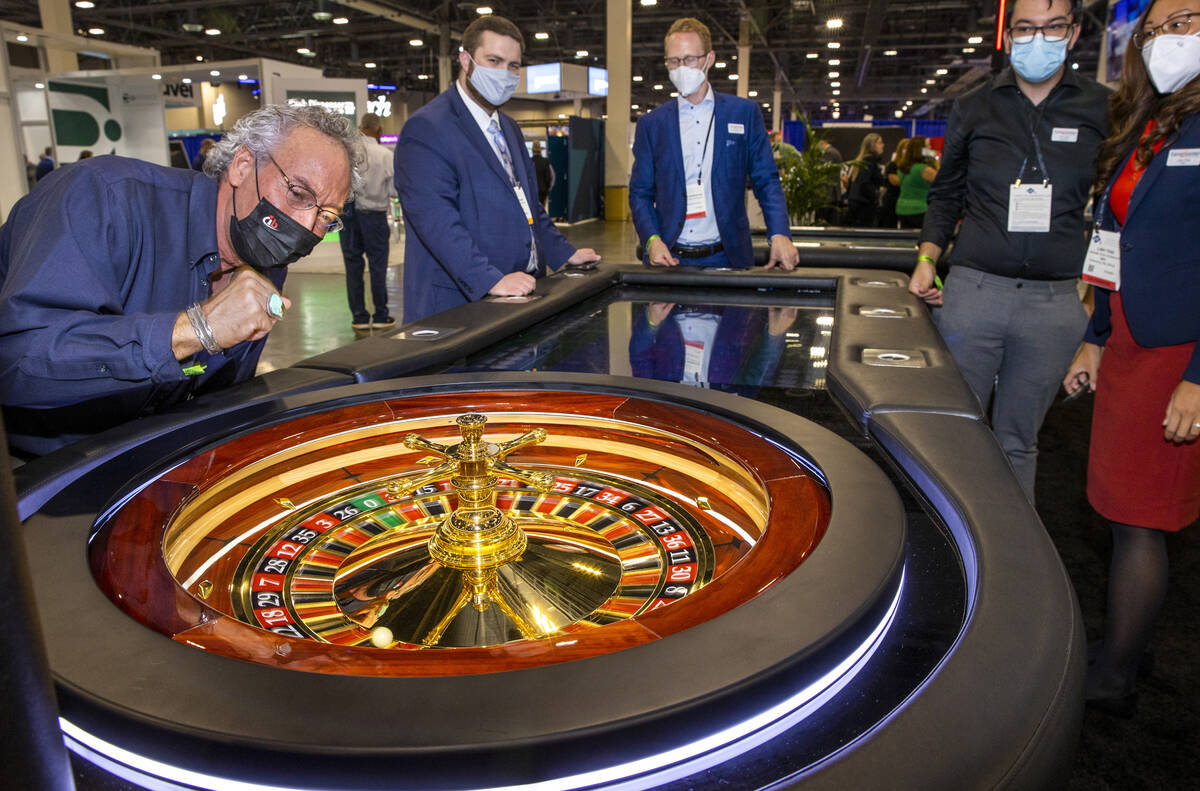 Attendee Ronald Gregrich hopes for a winner on a Roulette wheel at the tangiamo display area du ...