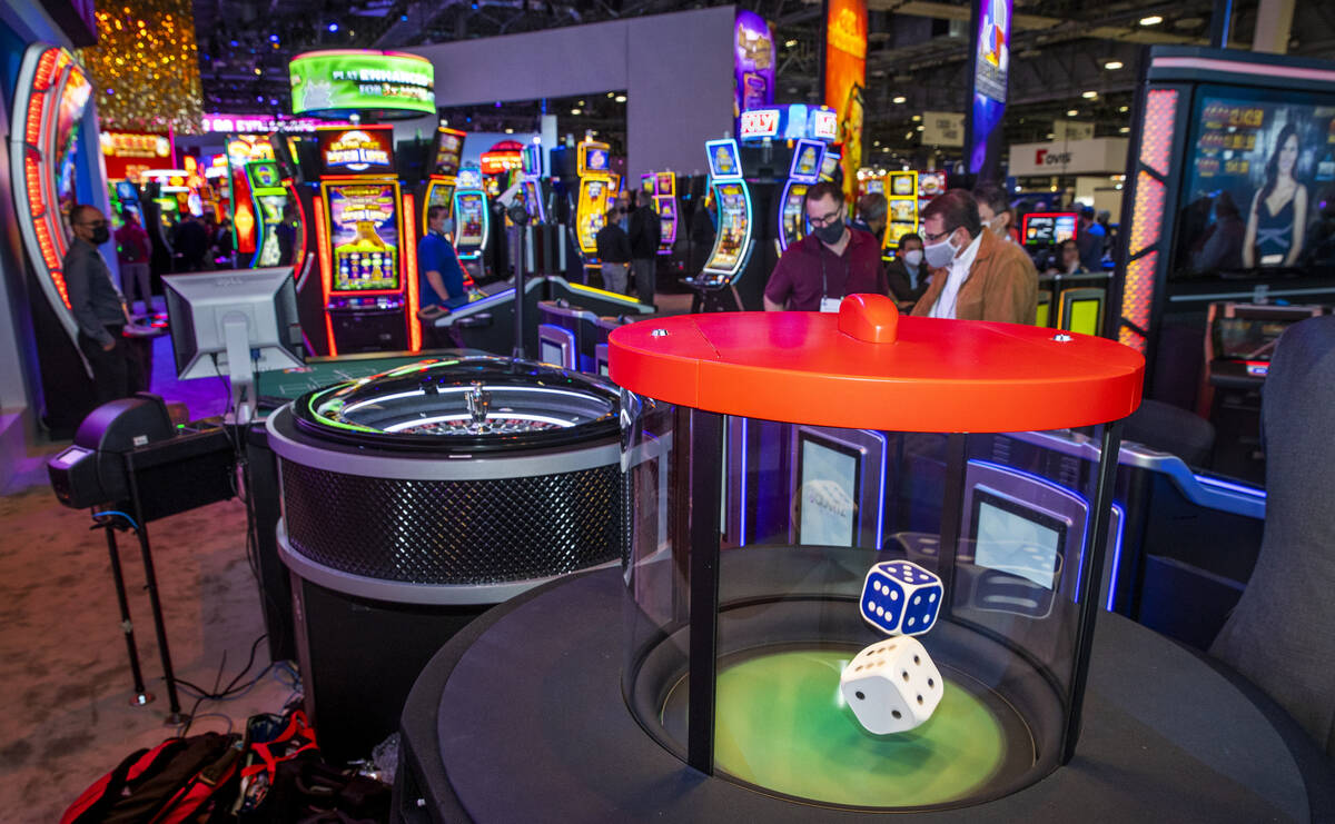 Dice hop during a roll in the new stadium seating and gaming spot about the Scientific Games Co ...