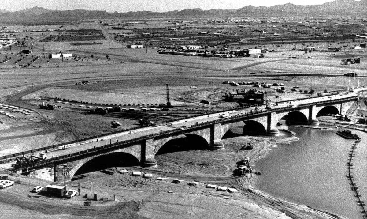 The historic London Bridge straddles a moat of water during its reconstruction in Lake Havasu C ...