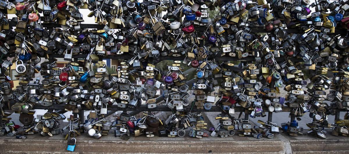 Love padlocks left by visitors are seen on London Bridge on Sunday, Oct. 3, 2021, in Lake Havas ...
