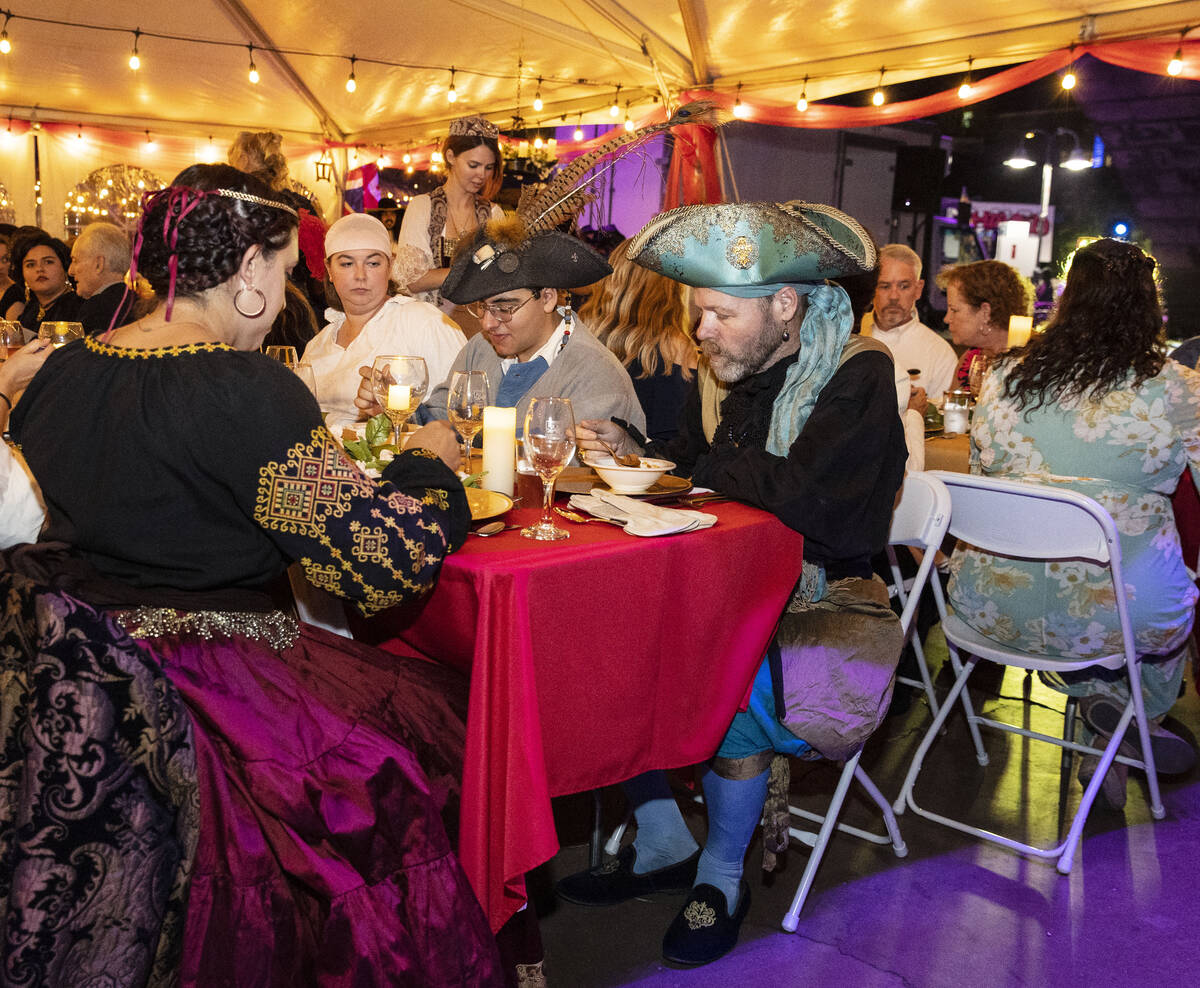 Attendees enjoy their meal during Royal Jubilee Celebration for the 50th anniversary of the Lon ...
