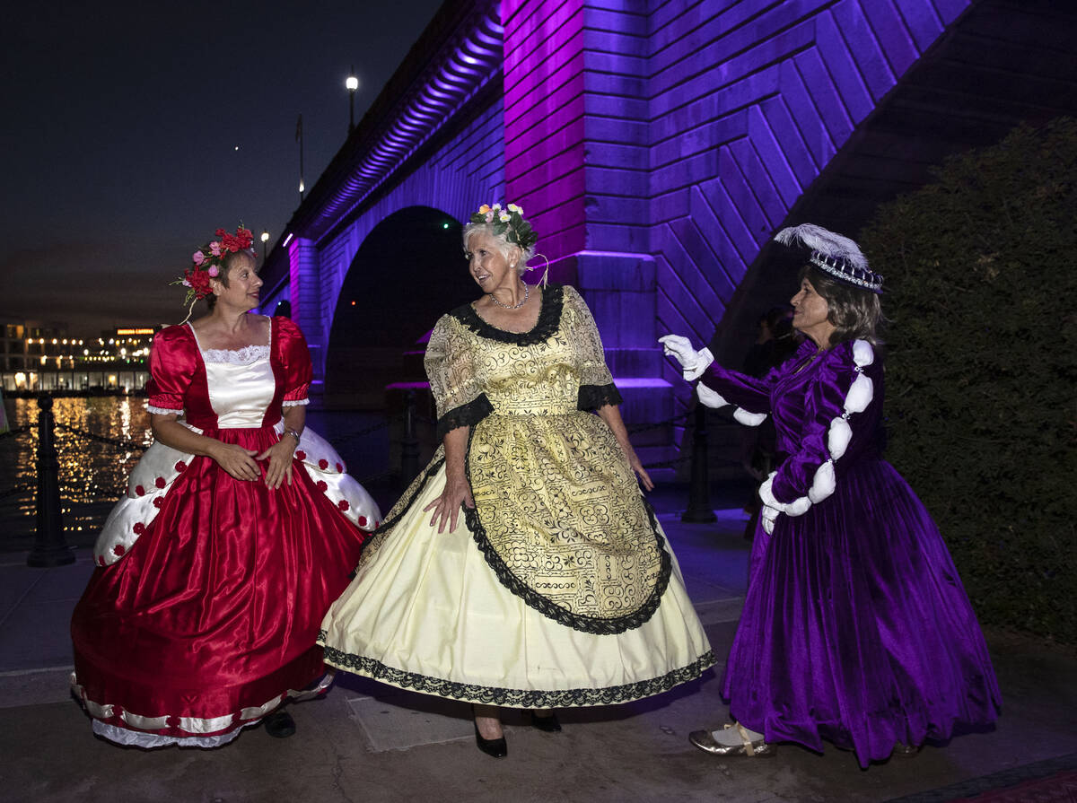 Leslie Rosario, left, Rise Mann, dressed as a lady-in-waiting, in medieval times, and Sandra Wi ...