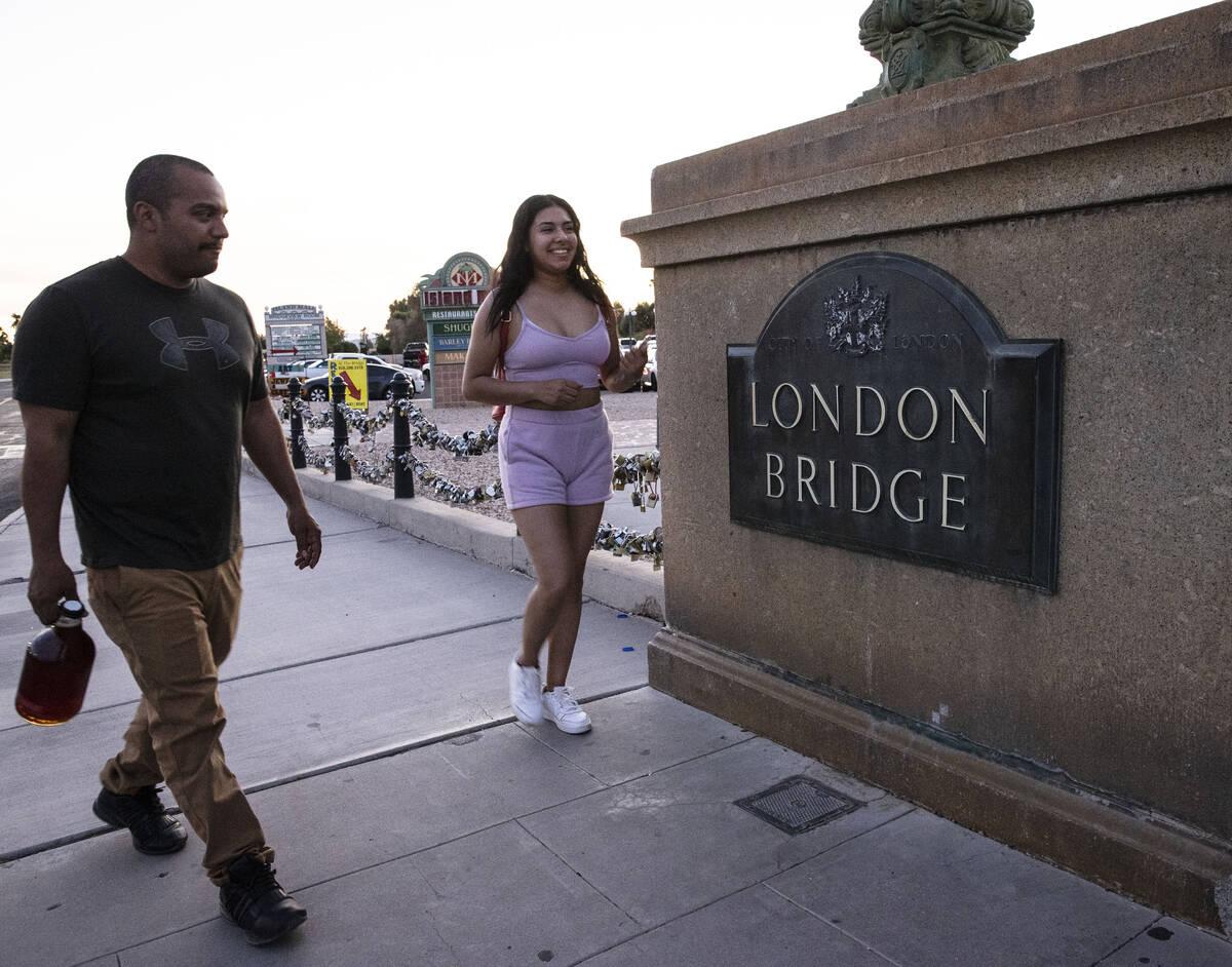 Pedestrians walk across London Bridge on Saturday, Oct. 2, 2021, in Lake Havasu, Ariz. (Bizuaye ...