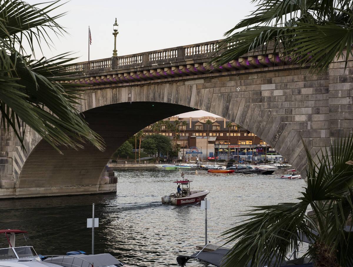 A boat travels under London Bridge on Saturday, Oct. 2, 2021, in Lake Havasu, Ariz. (Bizuayehu ...
