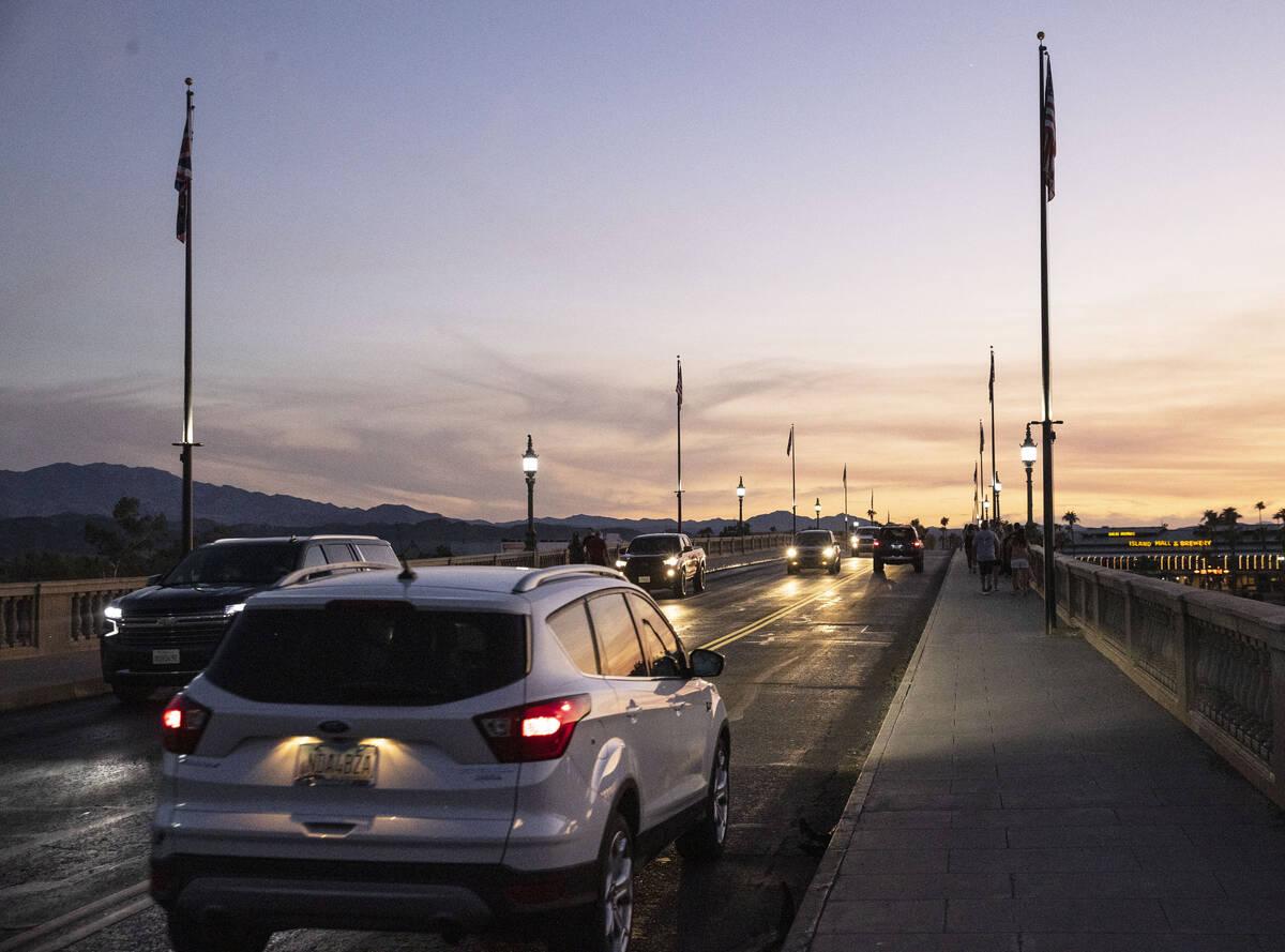Commuters cross London Bridge on Saturday, Oct. 2, 2021, in Lake Havasu, Ariz. (Bizuayehu Tesfa ...