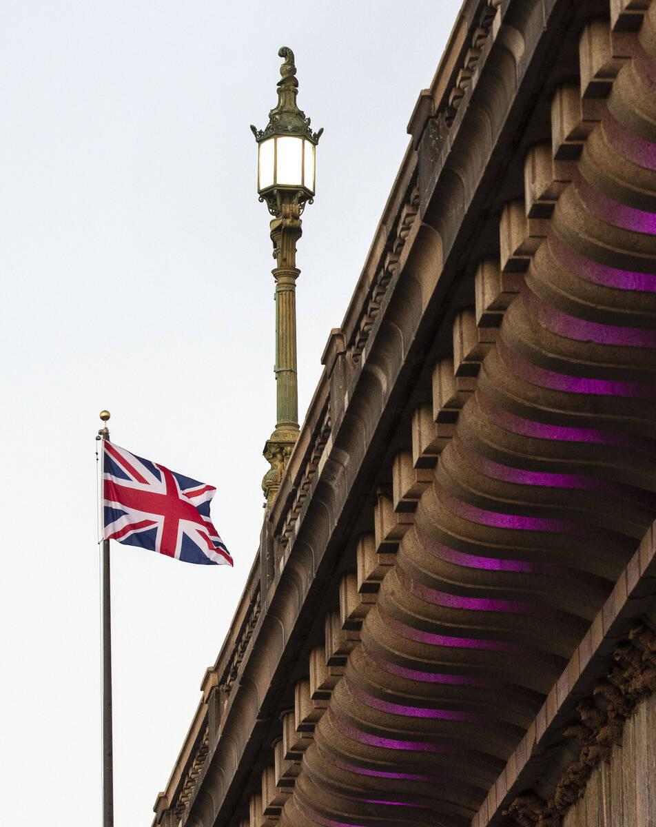 A British flag flies high above the London Bridge on Saturday, Oct. 2, 2021, in Lake Havasu, Ar ...