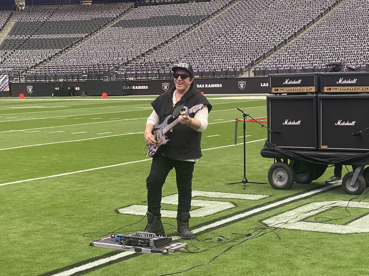 Neal Schon plays during a rehearsal Saturday at Allegiant Stadium for his Sunday performances a ...