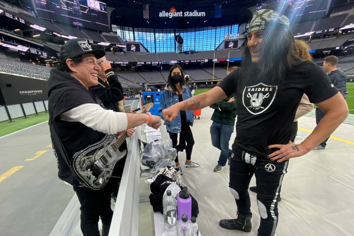 Neal Schon and Criss Angel greet each other during rehearsals Saturday at Allegiant Stadium for ...