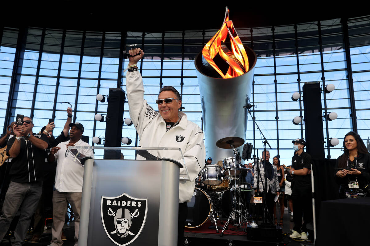 Las Vegas Labor Union Leader Tommy White lights the Al David Memorial Torch before the Raiders ...