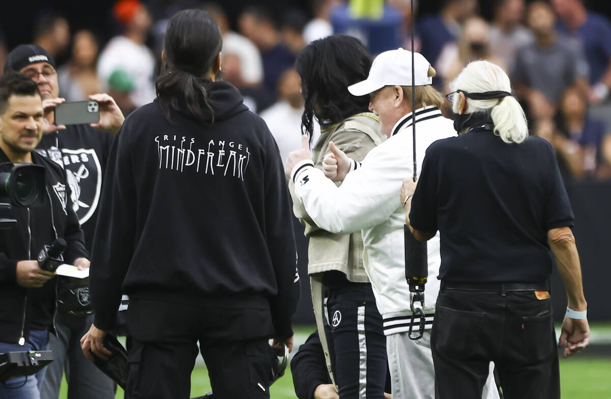 """Raiders owner Mark Davis gives thumbs up as magician and """"Mindfreak"""" star Criss Angel ..."""