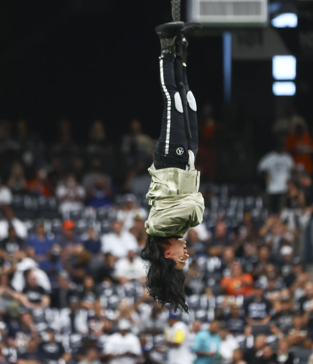 """Magician and """"Mindfreak"""" star Criss Angel is raised before dangling over 100 feet in ..."""