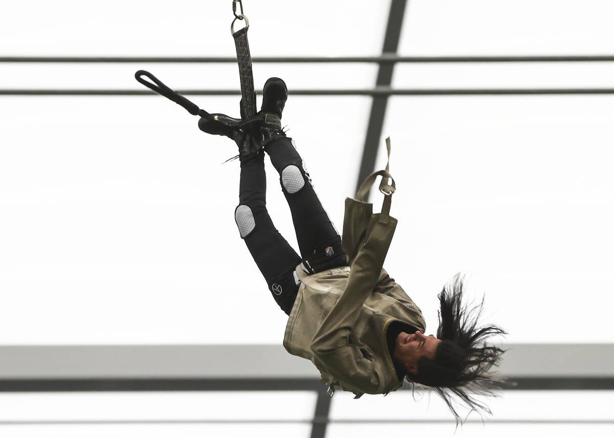 """Magician and """"Mindfreak"""" star Criss Angel, dangling over 100 feet in the air in Alleg ..."""